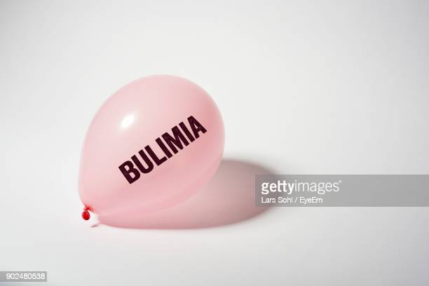 Close-Up Of Balloon With Text On White Background