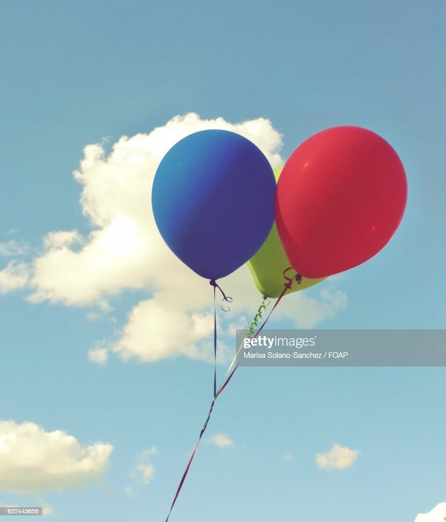 Close-up of balloons in sky : Stock Photo