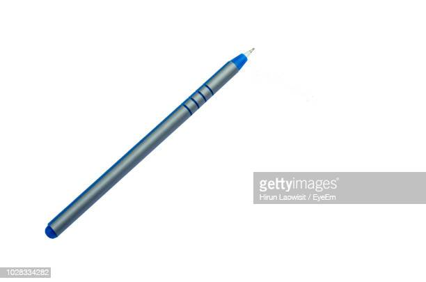 close-up of ballpoint pen over white background - ballpoint pen stock photos and pictures