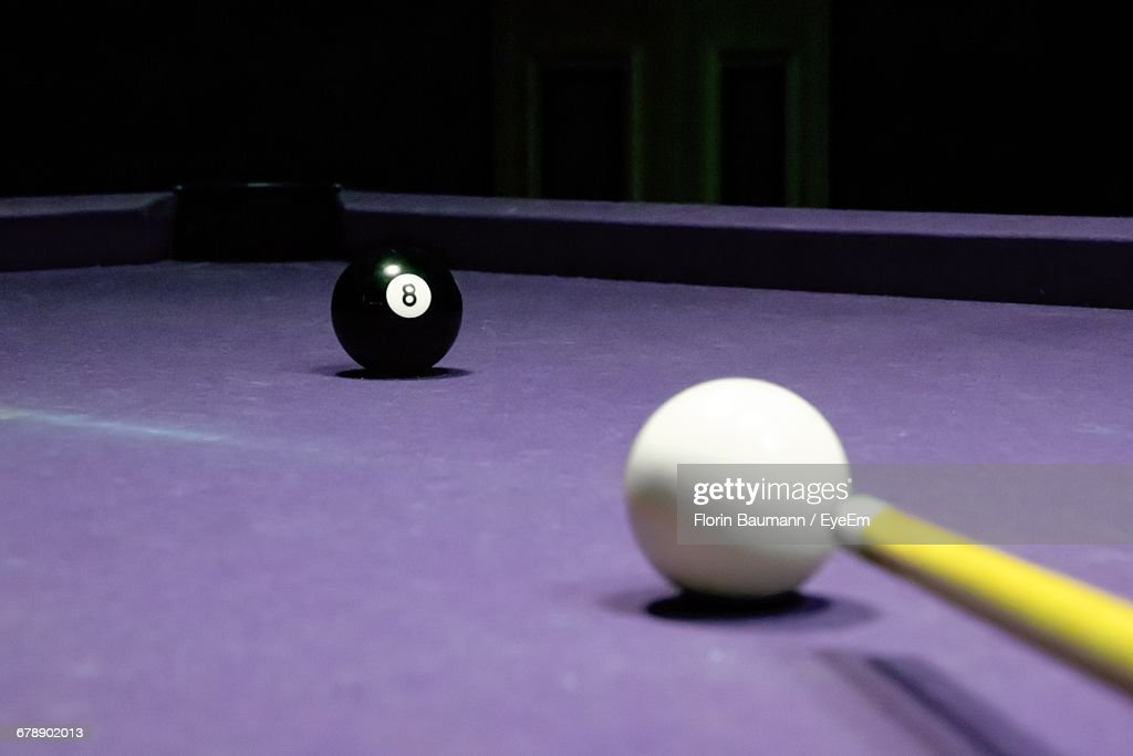 Close-up Of Balls And Cue On Pool Table : Stock Photo