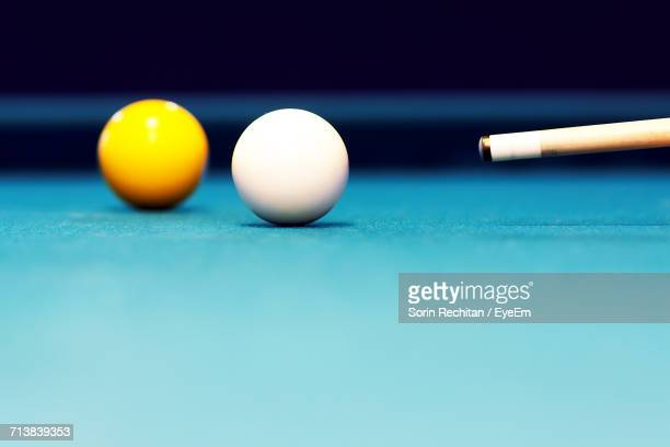Close-Up Of Balls And Cue On Pool Table