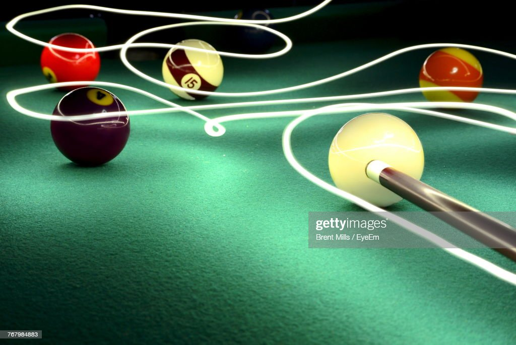 Closeup Of Balls On Pool Table With Light Painting High Res Stock Photo Getty Images