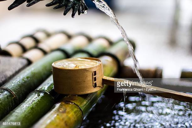 close-up of bamboo dipper in japanese garden - bamboo dipper stock photos and pictures