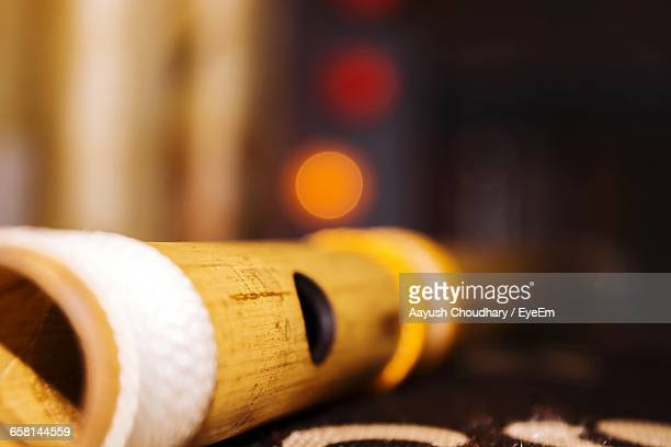 close-up of bamboo flute on table - bamboo flute stock photos and pictures