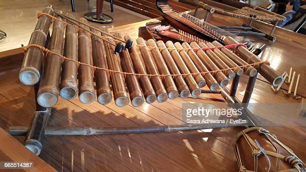 close-up of bamboo xylophone with other musical instruments - bamboo instrument stock photos and pictures