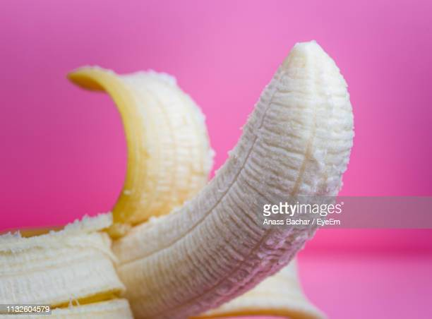 Close-Up Of Banana Against Pink Background