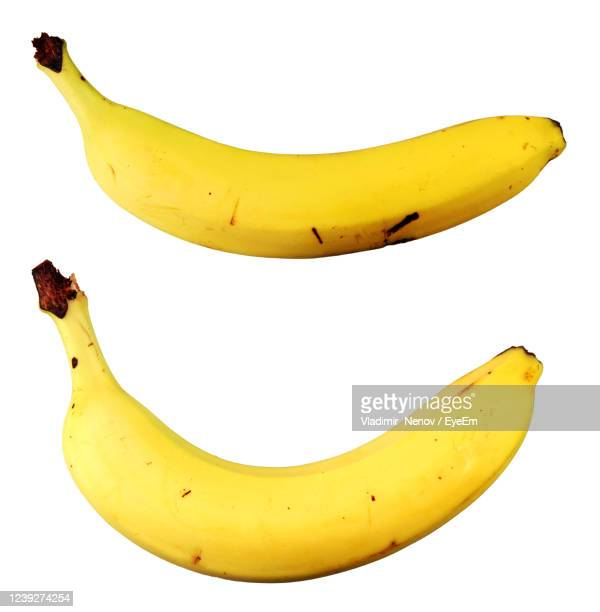 close-up of banana against white background - banana stock pictures, royalty-free photos & images