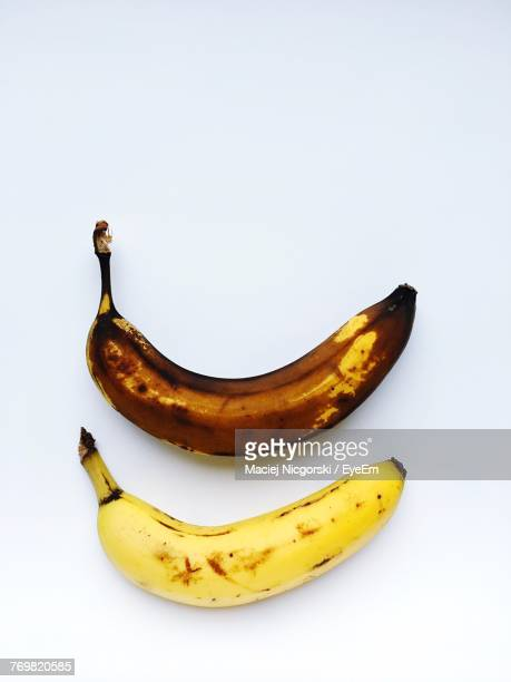 close-up of banana against white background - rotting stock pictures, royalty-free photos & images