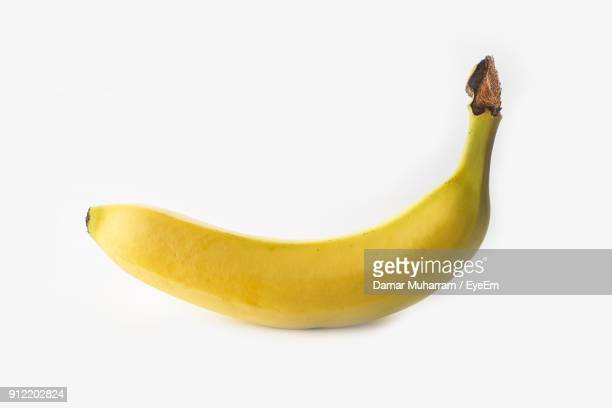 close-up of banana against white background - banana fotografías e imágenes de stock