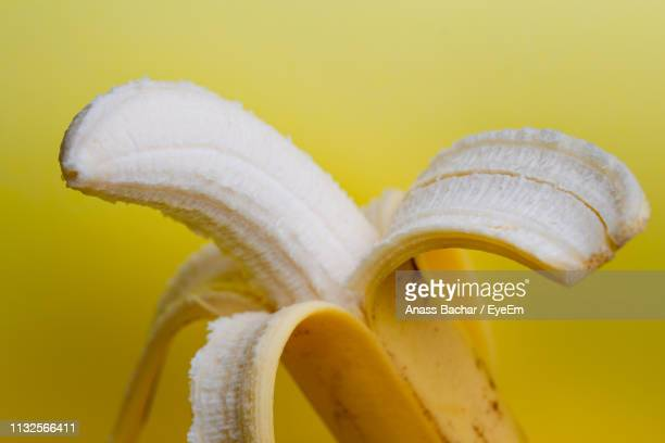 Close-Up Of Banana Against Yellow Background