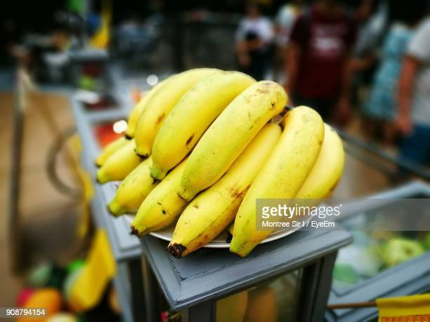 Close-Up Of Banana On Table For Sale In Market