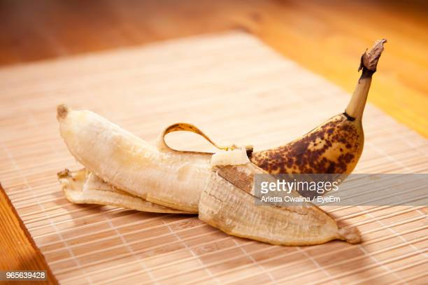 Close-Up Of Banana On Wooden Table