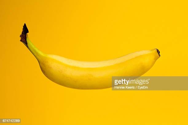 Close-Up Of Banana On Yellow Background