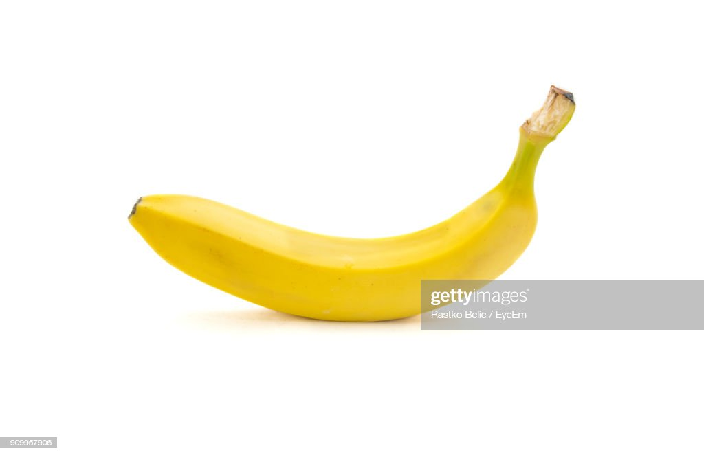 Close-Up Of Banana Over White Background : Stock Photo