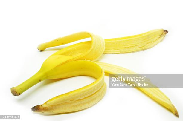 close-up of banana peel on white background - 果物の皮 ストックフォトと画像