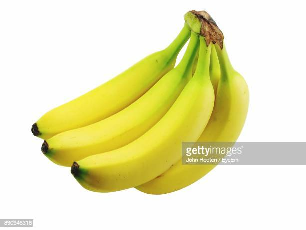 close-up of bananas against white background - banana fotografías e imágenes de stock