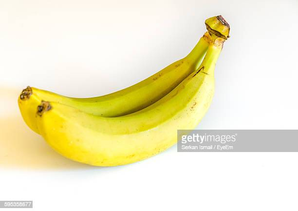 Close-Up Of Bananas Over White Background