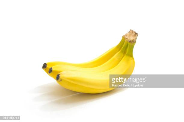 close-up of bananas over white background - banana fotografías e imágenes de stock