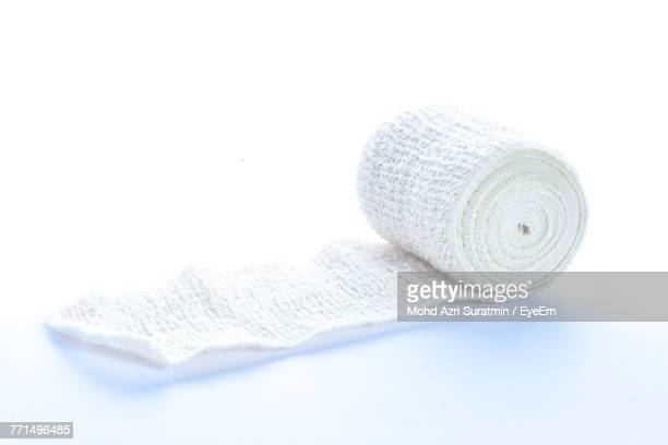 close-up of bandage over white background - bandage stock photos and pictures