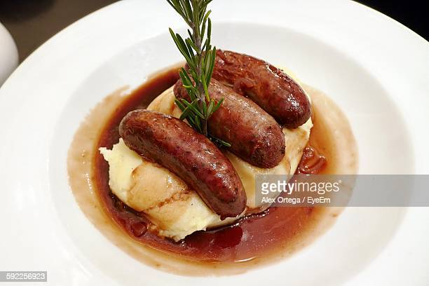 Close-Up Of Bangers And Mash Served In Plate