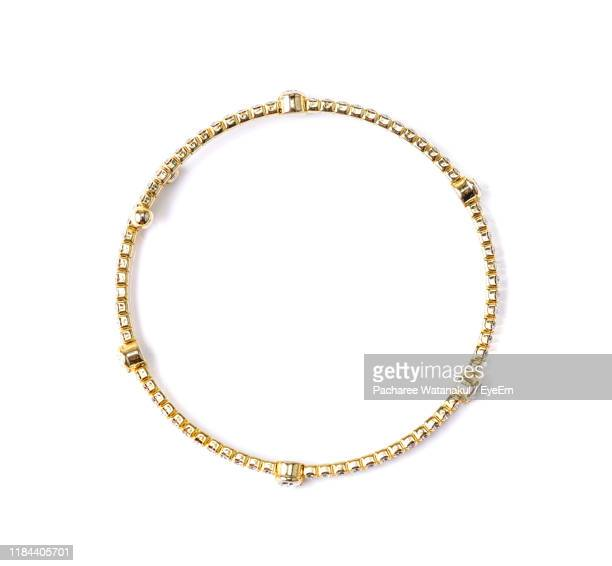close-up of bangle on white background - bracelet stock pictures, royalty-free photos & images