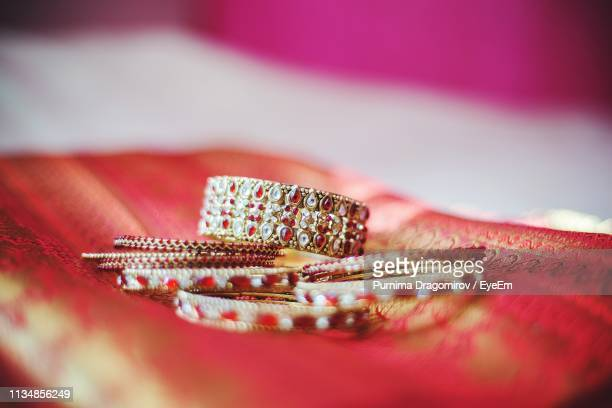 close-up of bangles on sari - bangle stock pictures, royalty-free photos & images