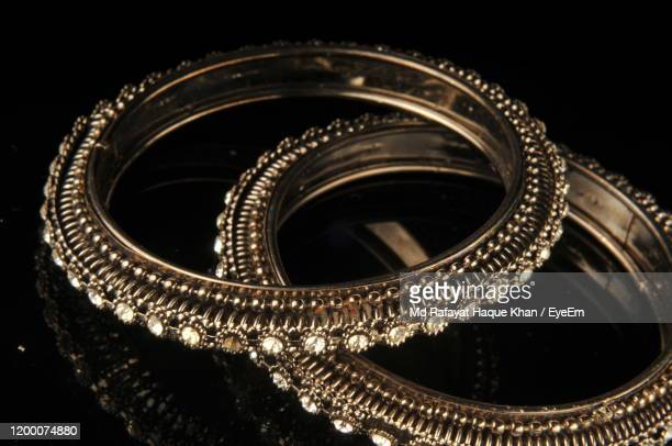 close-up of bangles on table - bangle stock pictures, royalty-free photos & images