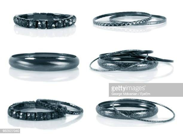 close-up of bangles over white background - bangle stock pictures, royalty-free photos & images