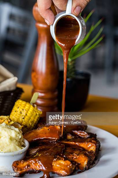 close-up of barbecue rips - barbeque sauce stock photos and pictures
