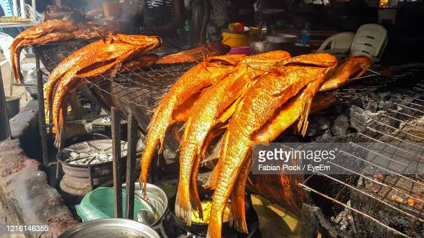 close-up of barbecued fish for sale at market - nigeria stock pictures, royalty-free photos & images