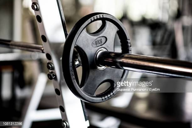 close-up of barbell in gym - barbell stock pictures, royalty-free photos & images