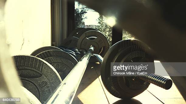 Close-Up Of Barbells And Weights At Gym