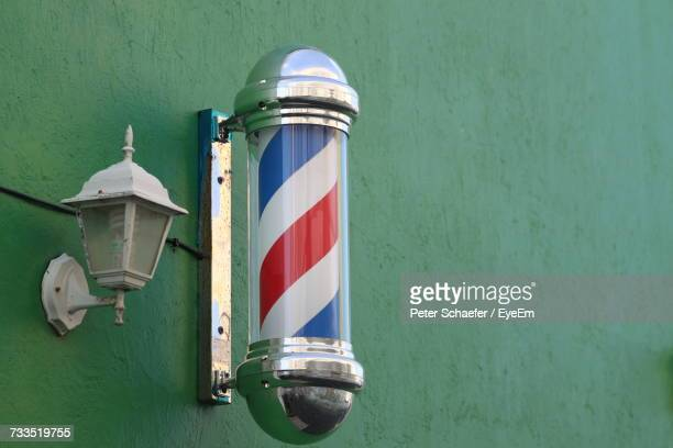close-up of barber shop sign - barber shop stock photos and pictures