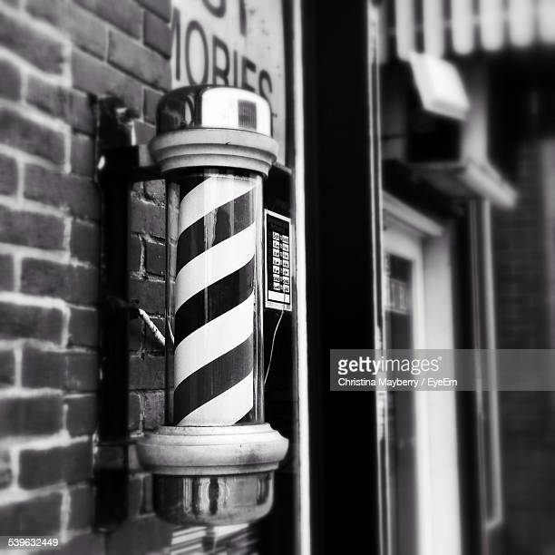 close-up of barber sign outside barber shop - barber pole stock photos and pictures