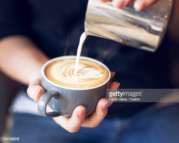 close-up of barista holding coffee cup - coffee stock photos and pictures