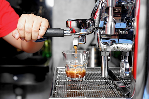 Close-up of barista making coffee in the Coffee Shop 1126630133