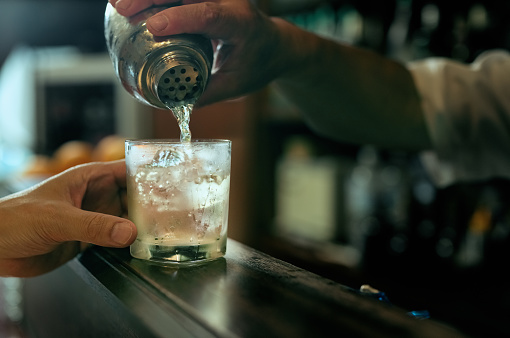 Close-up of bartender hand pouring cocktail - gettyimageskorea