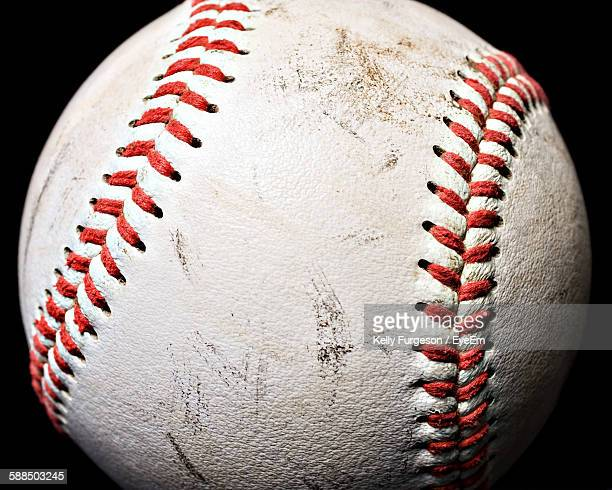 Close-Up Of Baseball Against Black Background