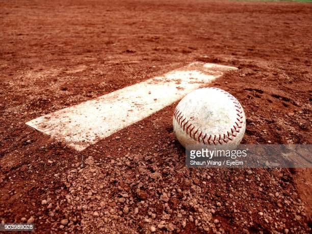 close-up of baseball ball on playing field - baseball ball stock photos and pictures