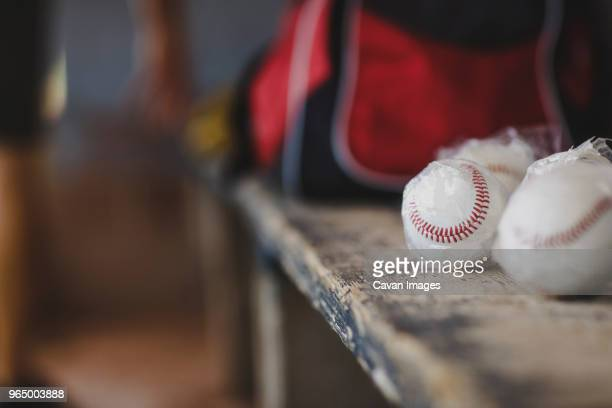 Close-up of baseball balls on table in sports dugout