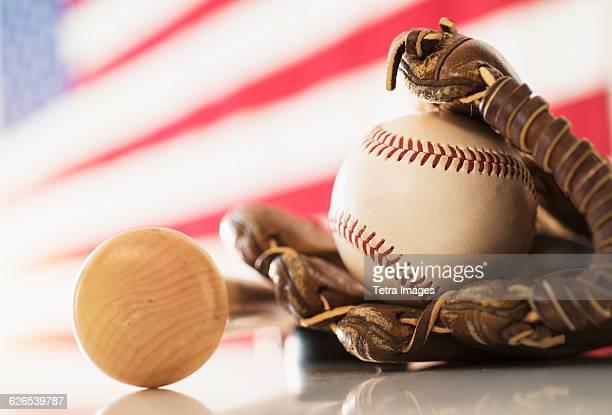 Close-up of baseball glove, ball and bat