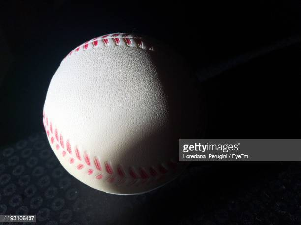 close-up of baseball on table - loredana perugini stock pictures, royalty-free photos & images