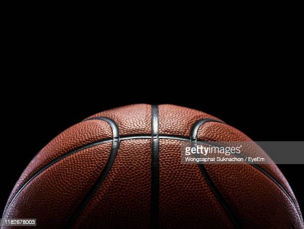 close-up of basketball against black background - sport stock pictures, royalty-free photos & images