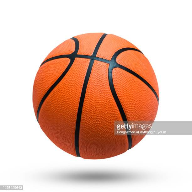 close-up of basketball against white background - basketbal teamsport stockfoto's en -beelden