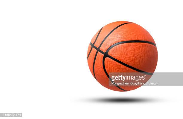 close-up of basketball against white background - sports ball stock pictures, royalty-free photos & images