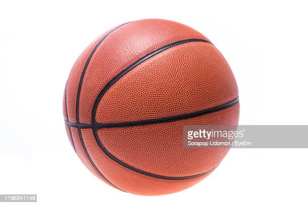 close-up of basketball against white background - spielball stock-fotos und bilder