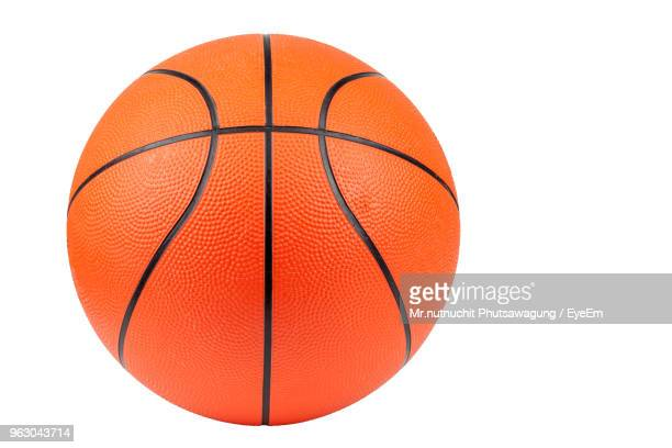 close-up of basketball against white background - bola de basquete - fotografias e filmes do acervo