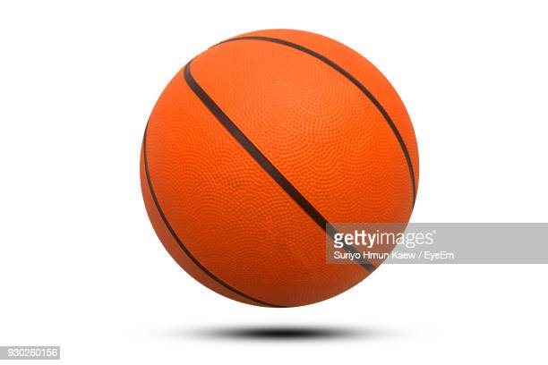 close-up of basketball ball against white background - basketball stock-fotos und bilder
