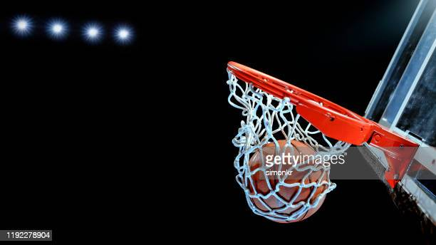 close-up of basketball in hoop - basketball hoop stock pictures, royalty-free photos & images