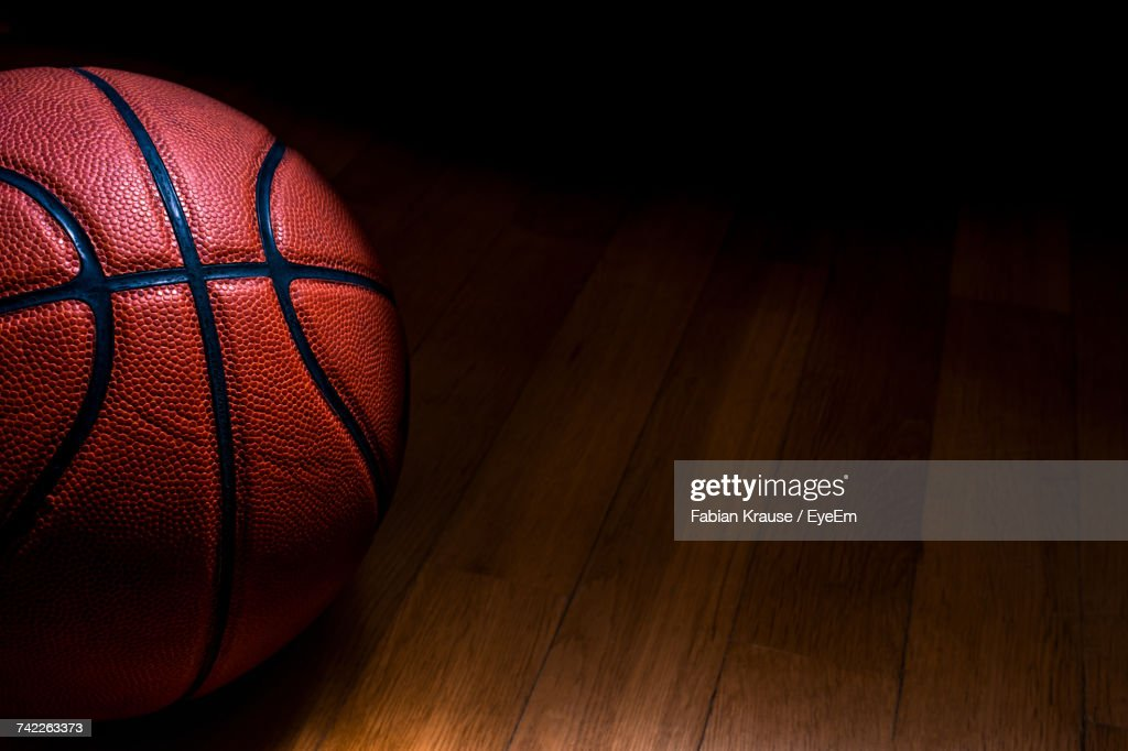 Close-Up Of Basketball On Hardwood Floor : Stock Photo